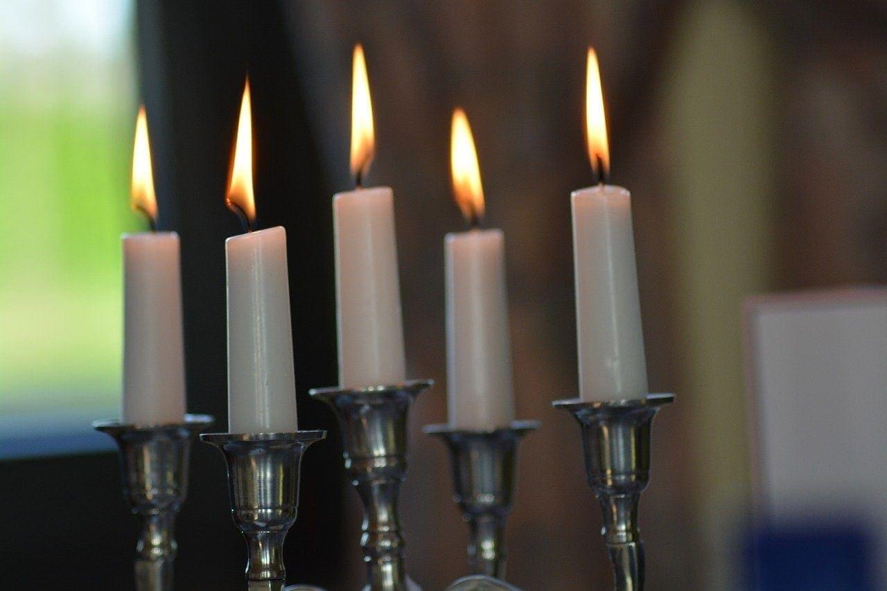 Why do women light Shabbat candles and not men?